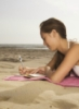 Diary (writing on beach)