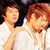 Chun Touching Su's Shoulder
