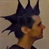 Kurt Onstad: spiky blue hair in profile