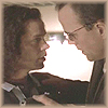 Jim and Blair touching