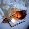 wrldpossibility: stock boy reading in bed