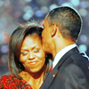 happy is as happy does: Barack kissing Michelle. (don't hate)