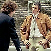 Bodie/Doyle hands on hips looking