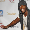 peaches in the creases of a plastic bag: ALDIS HODGE is flying