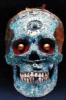 Плиний Цигенхальс: Cráneo humano con incrustaciones