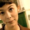 Audrey Tautou/Amélie scowl