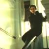 Kate: Tom on the banister