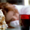 Bones Brennan asleep with coffee cup