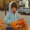 unintentionally intimidating: kid with leaves