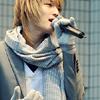 Boy singing into microphone (DBSK)