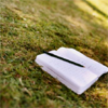 Notebook and pen on ground
