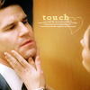 Brennan touching Booth's jaw
