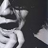 Jin picking his teeth..