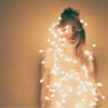 christmas lights around girl