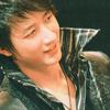 サラ: SuJu - geng in black with a smile