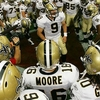 saints team huddle