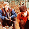 Arthur pokes Merlin with his big stick