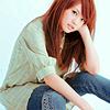 Actor: Rainie Yang sitting, her chin in her hand