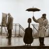 MIS: Man w/ umbrella over cello
