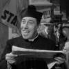 Дон Камилло с газетой
