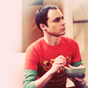 Emily: Sheldon - crouching on couch