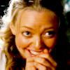 Alba DeTamble: giggling behind hand